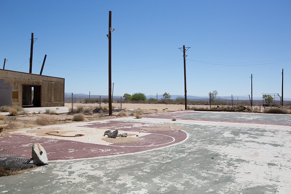 Abandoned basketball court and baseball field