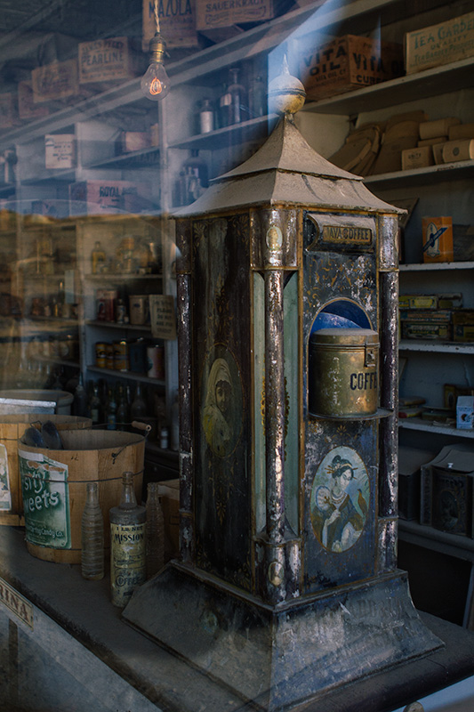 Jake Reinig Travel Photography | Bodie Ghost Town |  Interior of a Store, Working Light Bulb, Coffee Machine